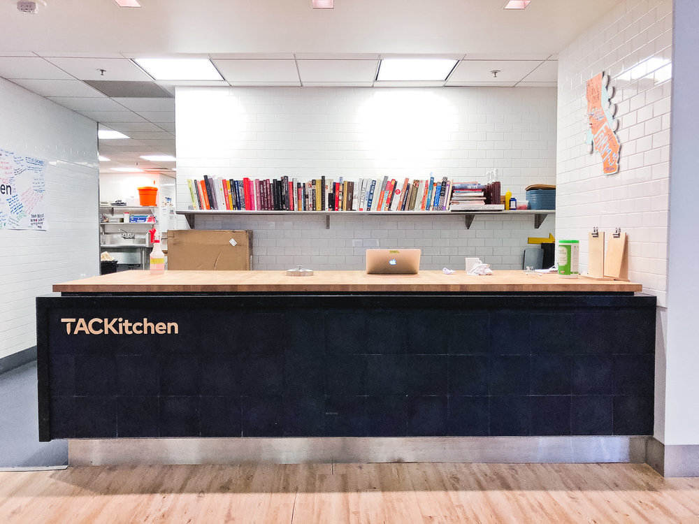 A custom logo was created for our beloved TACKitchen, and is proudly mounted on the kitchen's front desk area.