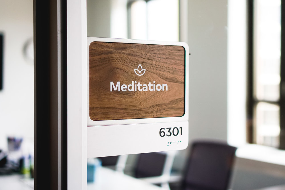 Each of the 60 rooms in the office has it's own walnut name-card, with a corresponding neighborhood meta icon. The extra icon helps reinforce the system so eventually people just understand where they are going without even having to look.