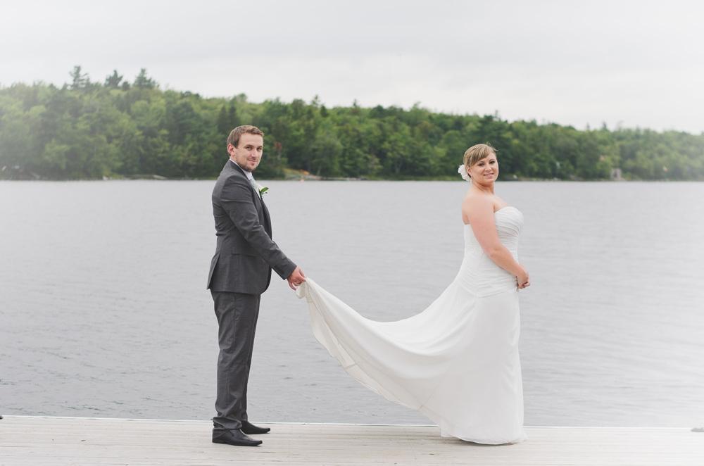 groom holding dress.jpg