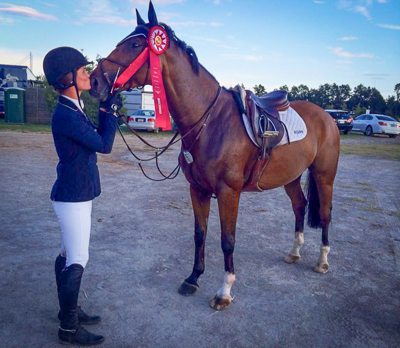 Erin McGuire thanks Kasarr for placing second in the $15,000 1.35m Open Jumper Classic.