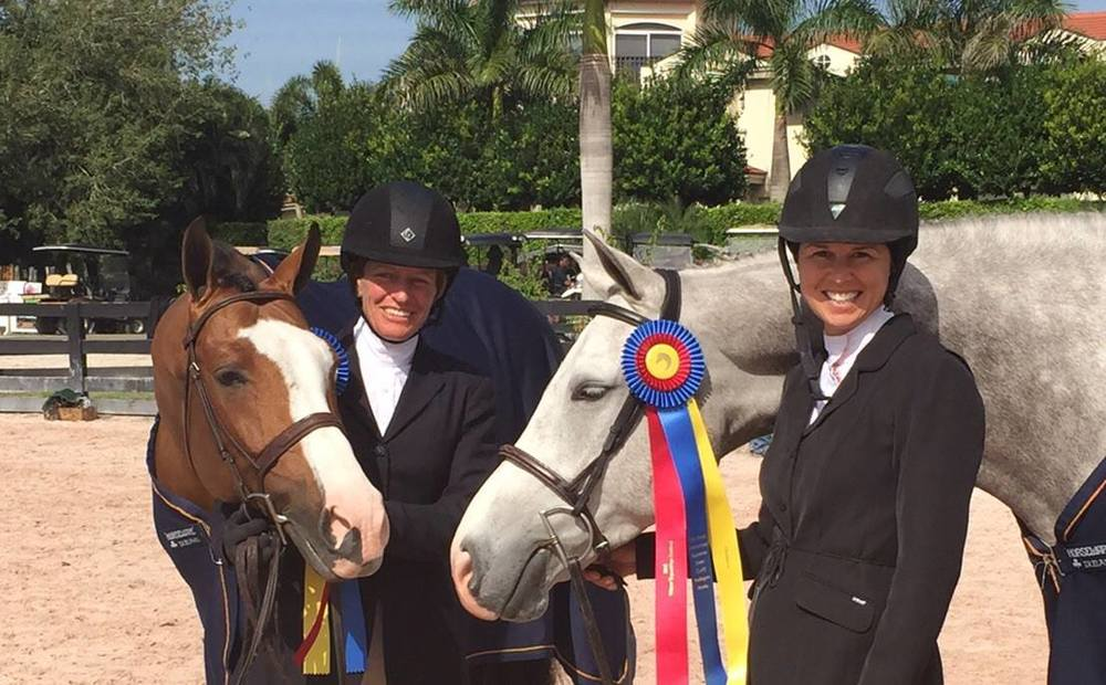 Liza Boyd, right, and Kelley Farmer celebrate their First Year Green Hunter Championships together during Week 1 of the Winter Equestrian Festival.
