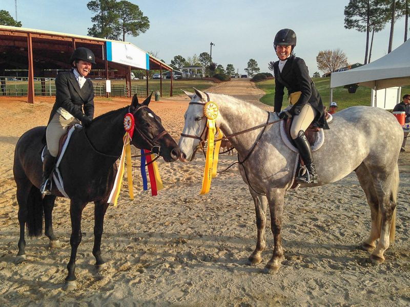 Liza Boyd and Sterling, right, celebrate their USHJA International Hunter Derby performance with winner Kelley Farmer aboard Mindful.
