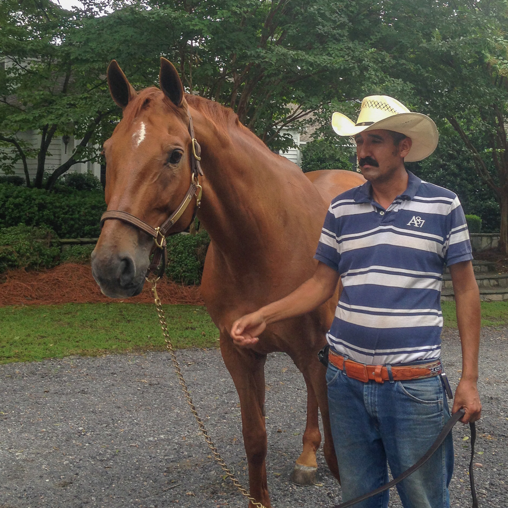Brunello poses for photographs with long-time groom Alberto Ramirez.