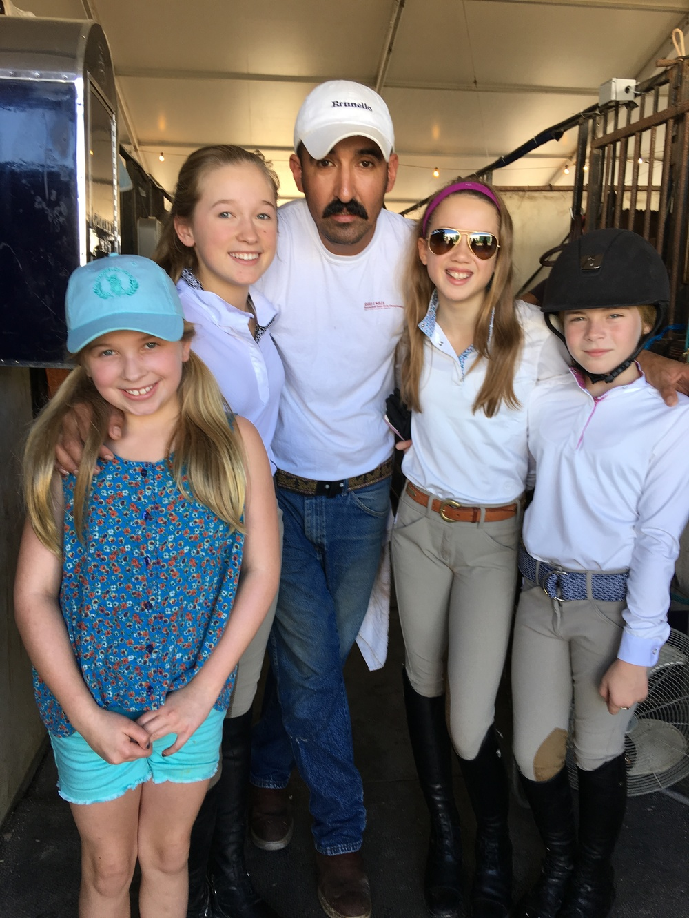 Alberto Ramirez with, from left, Ellie and Maggie Hill, Ruby Sloan and Zola Thompson enjoyed the first week of the Winter Equestrian Festival circuit.