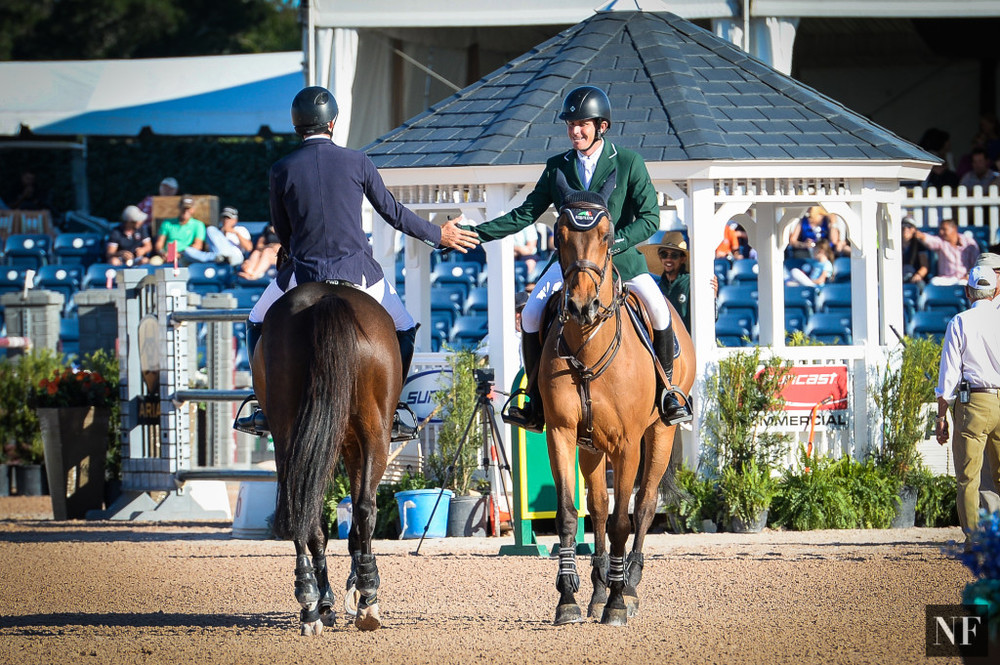 Competition, sportsmanship, camaraderie. When eventual $216,000 CSIO4* Grand Prix winner Darragh Kenny (right) passed Hardin Towell after a clear jump-off round on Sunday, March 6th in Wellington, Florida, a moment of congratulations and respect passed between the two. More than just a high-five, the moment between fierce competitors and good friends exemplified the best of a beautiful sport, a shared passion, and mutual goodwill.
