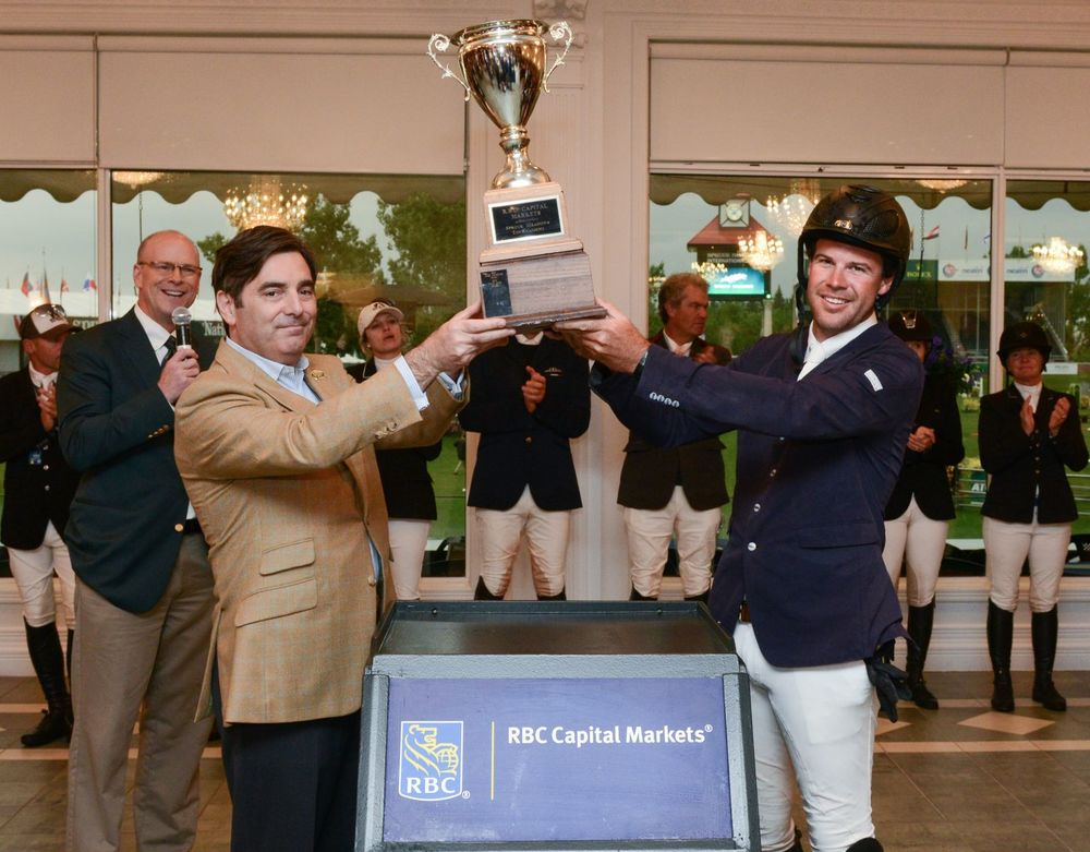 Hardin Towell hoists the championship trophy with David Dal Bello, managing director at RBC Capital Markets during the awards ceremony.