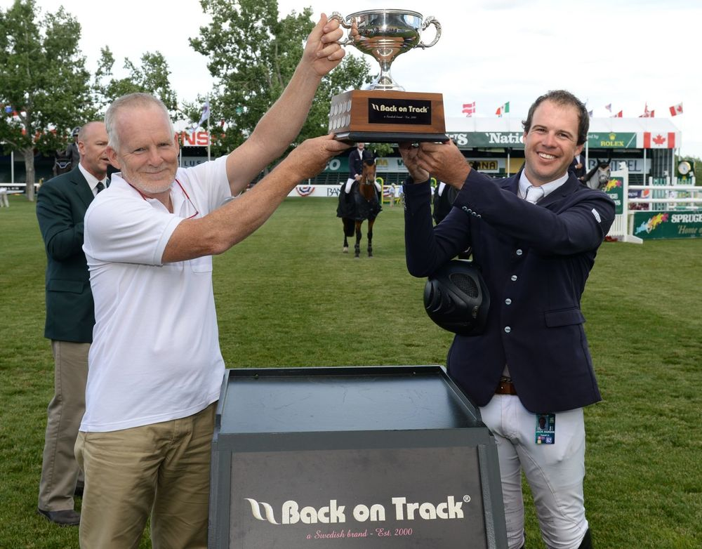 Hardin Towell hoists the Back on Track Trophy with Tim McLeod, acting president of Back on Track.