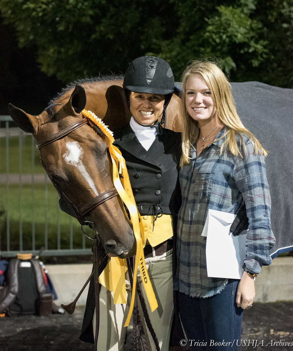 Liza Boyd and Stella Styslinger celebrate O'Ryan's third-placed finish in the USHJA International Hunter Derby Championship