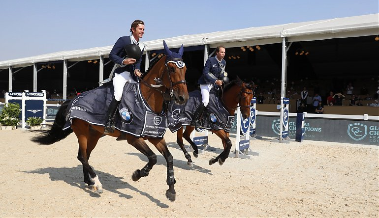 Darragh Kenny, left, and Hardin Towell lead the Longines Global Champions Tour victory lap in Shanghai.