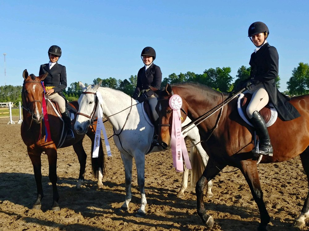 Liza Boyd with students Elly Ficca and Maggie Hill after the USHJA International Hunter Derby.