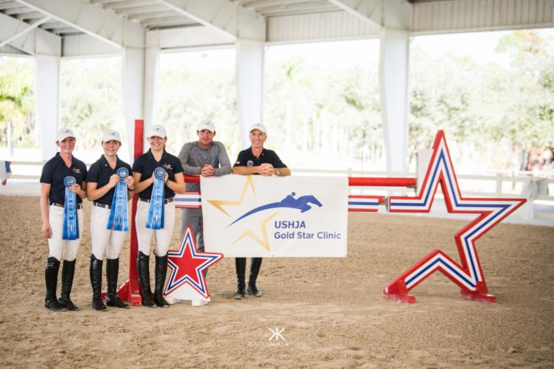 The winning team of Cathleen Driscoll, Cameron Tague and Sydney Stephenson with Chef d'Equipe Hardin Towell and Lead Clinician Richard Spooner. Kaitlyn Karssen/USHJA Photo