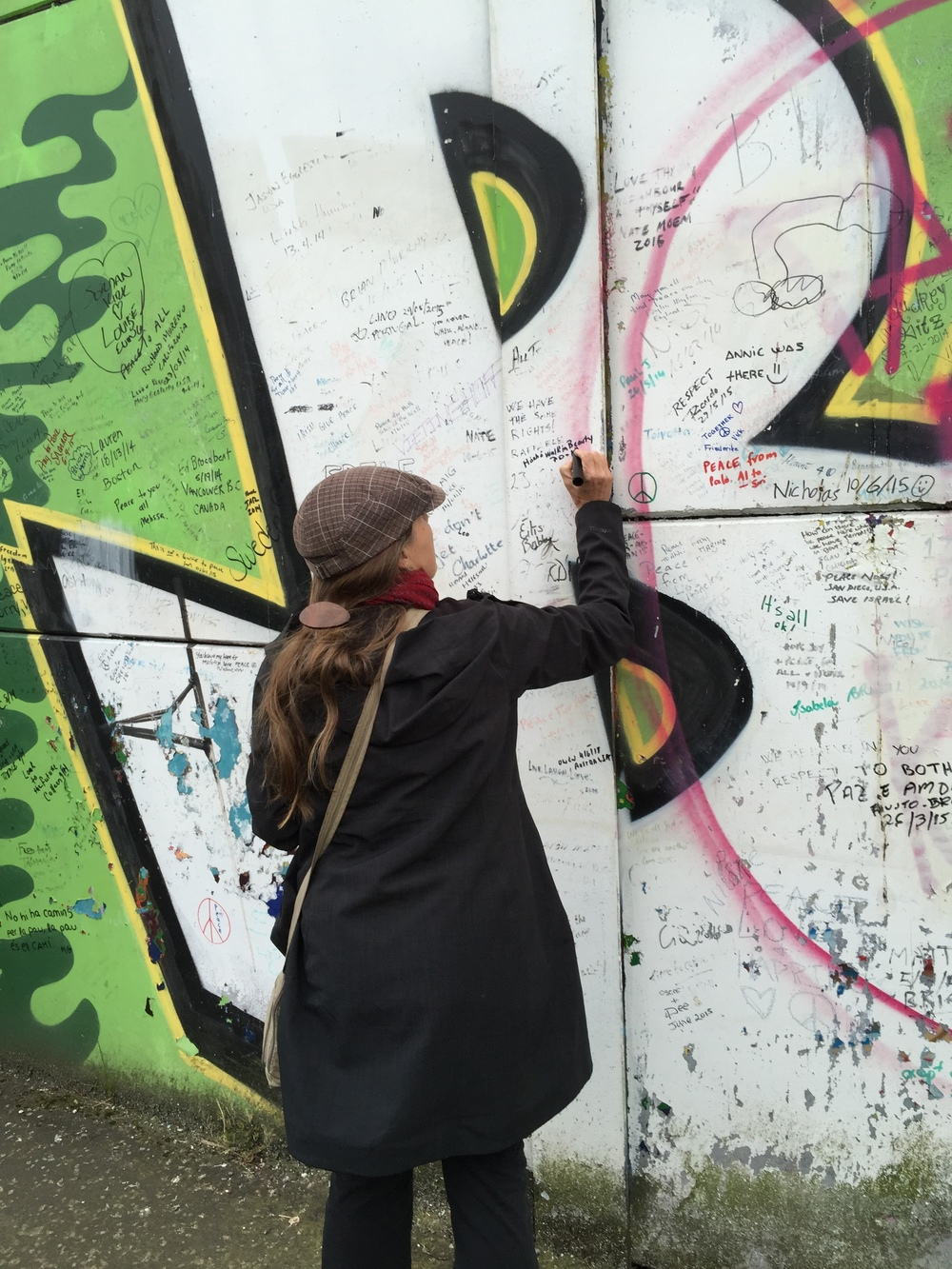 Me signing Peace Wall in Belfast.
