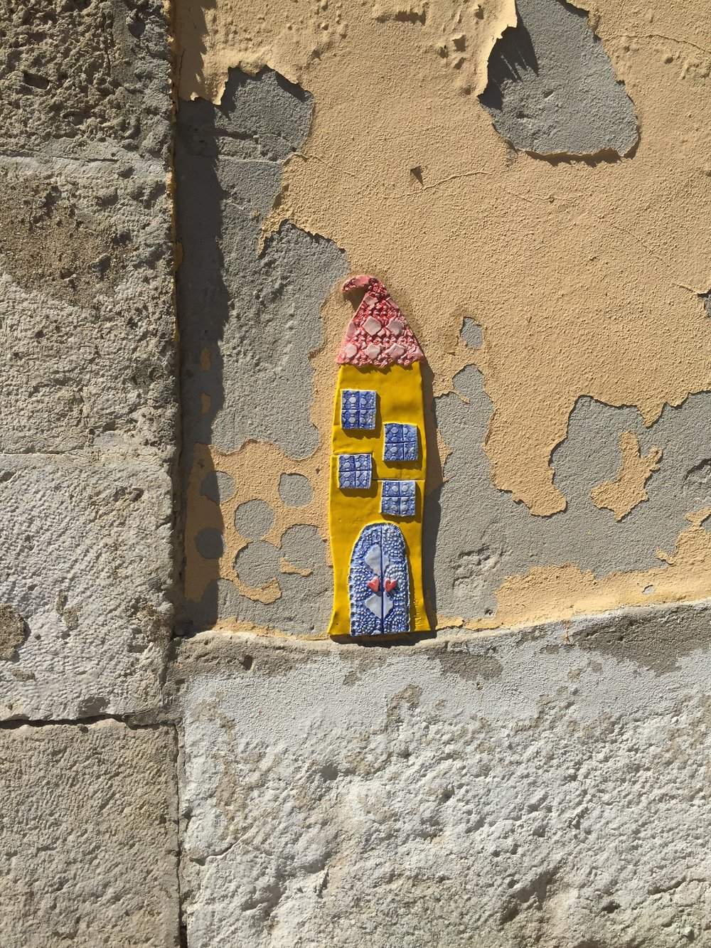 This lovely creation on the side of a children's store in Alfama.