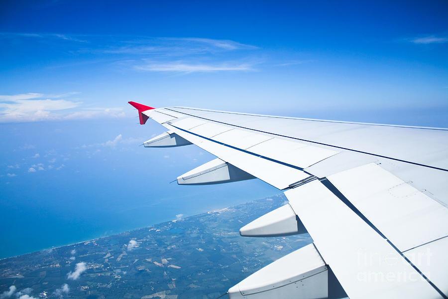 view-out-of-airplane-airplane-wing-in-flight-preecha-wannalert-.jpg