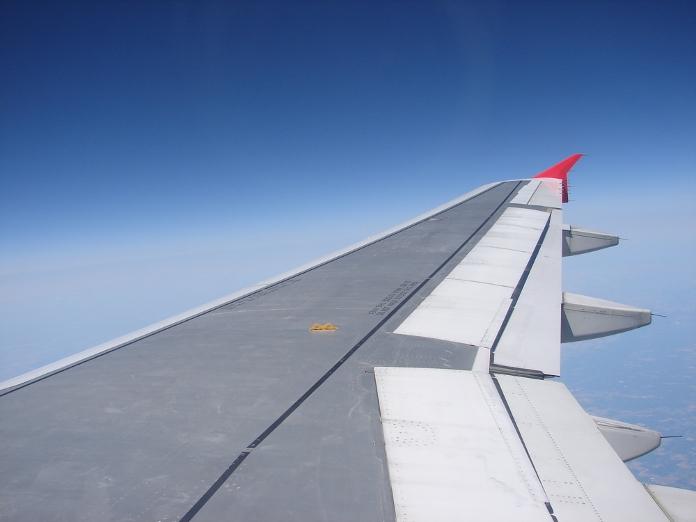 Airplane_Wing_in_the_Sky_by_FantasyStock.jpg
