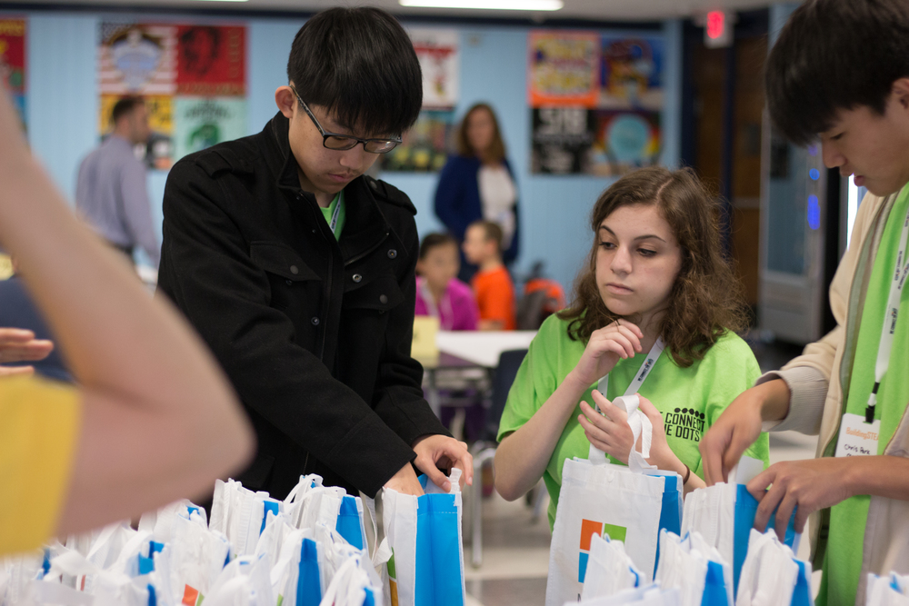 Student mentors from Plainview-Old Bethpage High School pack prize bags for participants.
