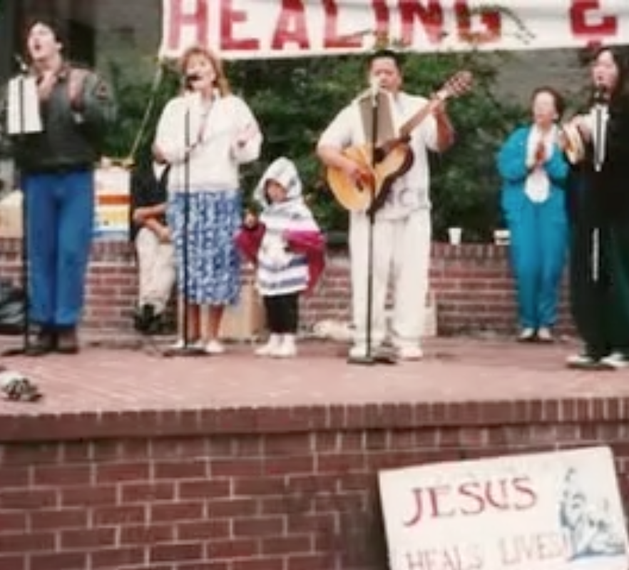 My dad leading worship through music at Church in the Park. I'm the little one, just hanging with my dad.