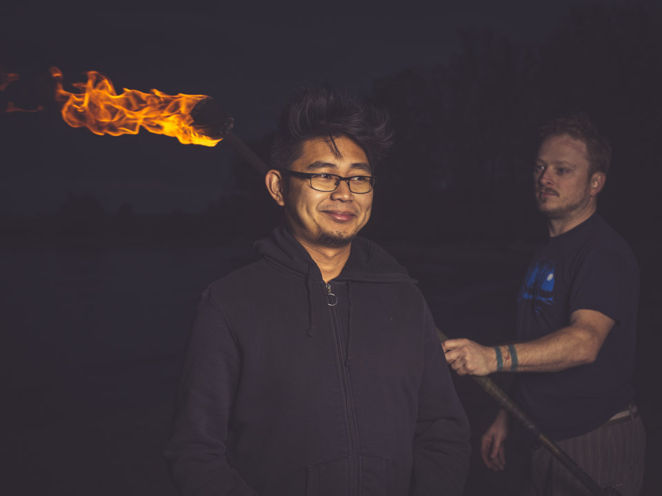 Brian  de Rivera Simon with fire spinner and photographer, Andrew Miller