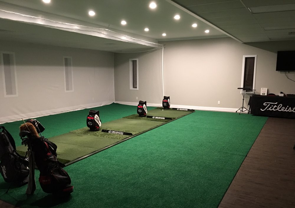 The indoor training facility consist of 3 hitting stations as well as a putting green and chipping areas.  Train your game from Tee to Green this Winter.