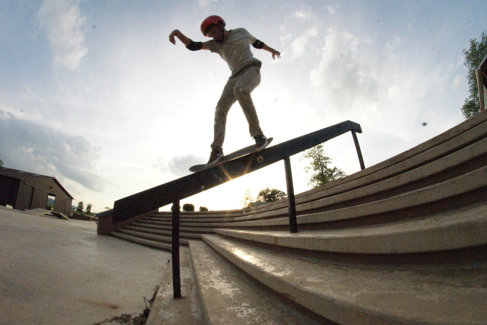 This picture is of my friend Austin Bland doing a backside feeble at Camp woodward. This rail is perfect for an 8 stair and this was just one of his warm up tricks. I love this photo because of the sun and how its under the rail and almost leaves a silhouette of him.