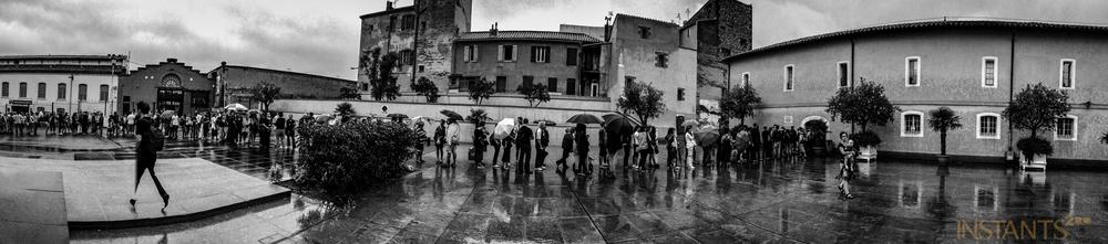 Perpignan, France - 08.09.2013 : Sous la pluie, people waiting in line to enter the main exhibition @ Couvent des Minimes.
