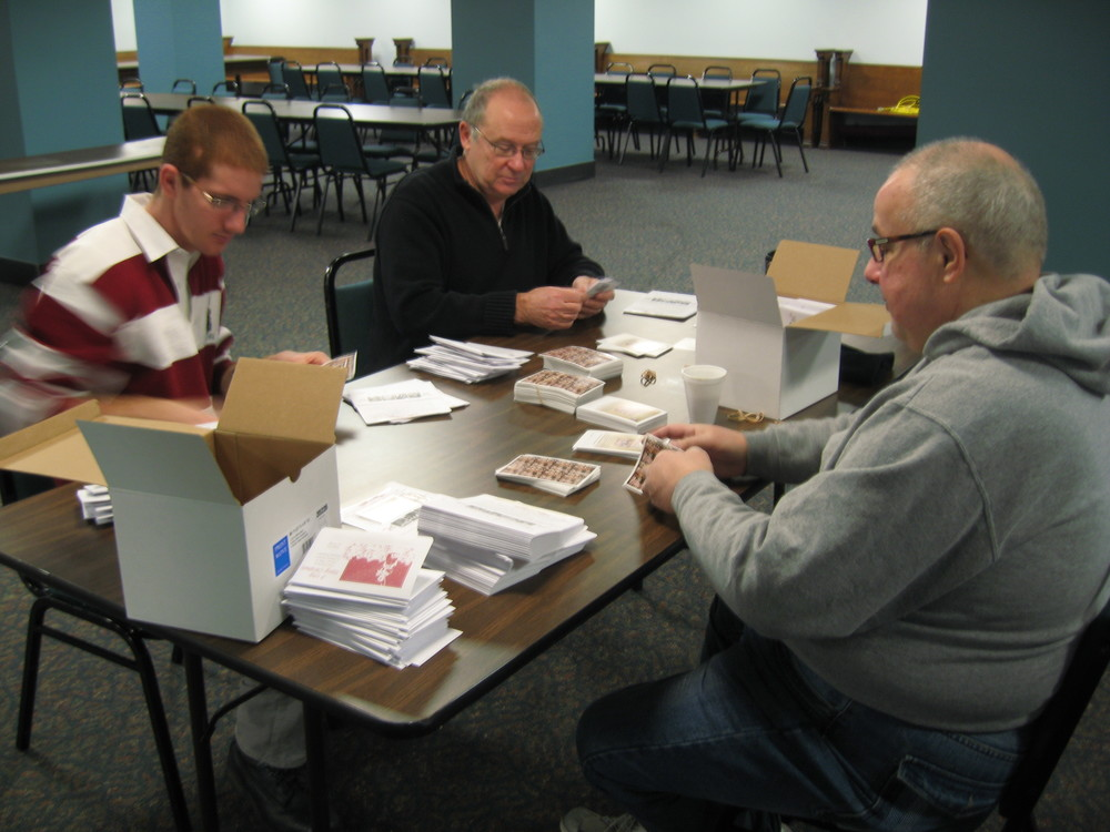 Brothers of Council 14474 preparing this year's Christmas Seals for the Sunday bulletins.