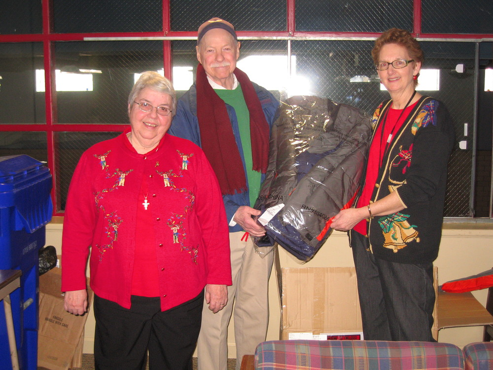Brother Ed with Sr. Lois and Tish Donze-Howard, Director of the Providence Family Support Center in the North Hills, holding a new coat for a child in need.