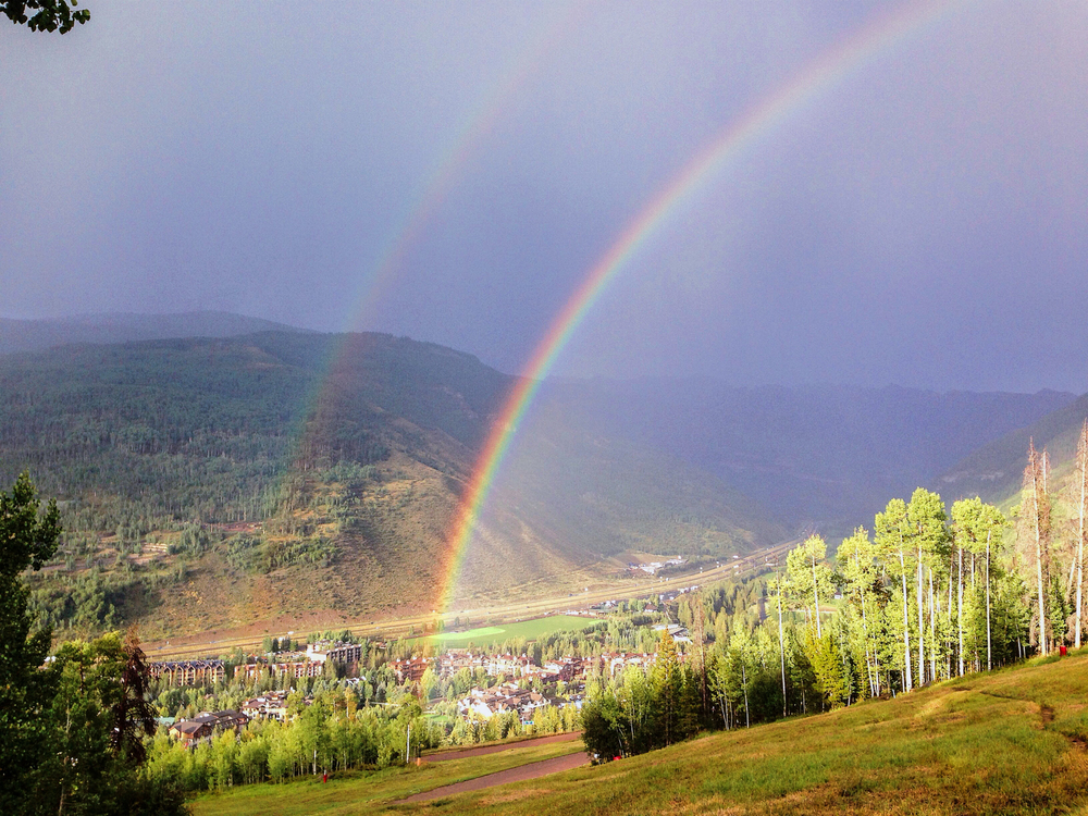 A double-rainbow after a mountain thunderstorm.