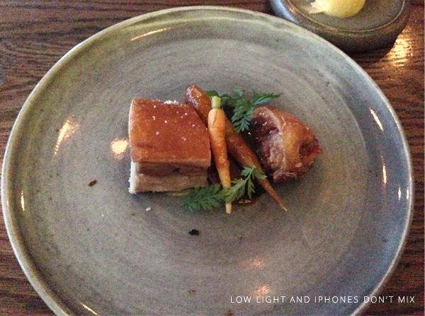 Roasted suckling pig, hay,baked carrots & mustard