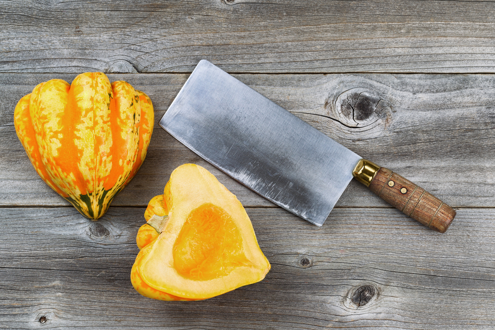 © Tab1962 | Dreamstime.com - Freshly Cut Squash With Large Knife On Rustic Wood Photo