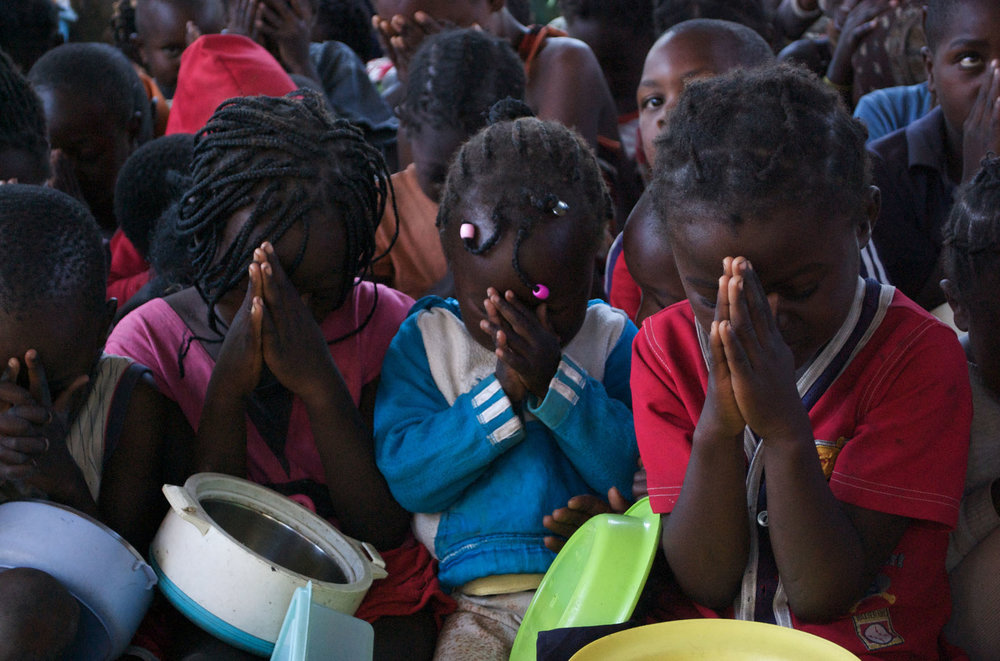 Zambia kids praying.jpg