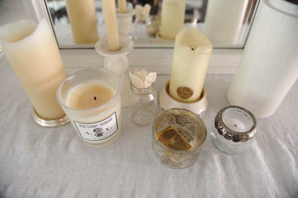 Mirror -  vintage  / Assorted candles and holders -  Astier de Villatte, Santa Maria Novella,  Northern Light, Brook Farm General Store, Janalli Home  / Brass Lighter -  vintage Zippo  / White case -  vintage