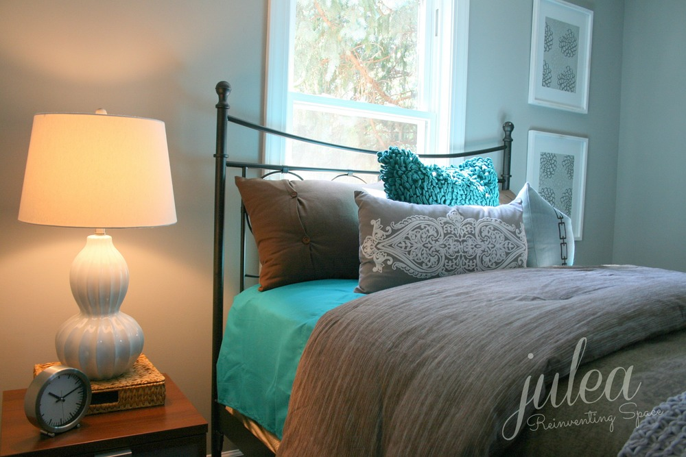 HOME STAGING TIP: Create added interest on a bed with a colorful accent pillows and textural throws.