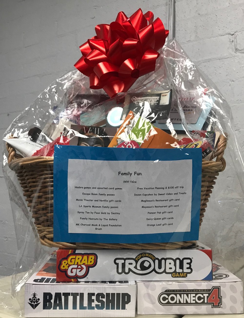 Family Fun Basket - Hasbro games and assorted card games, Escape Room family passes, Movie Theater and Netflix gift cards, LA Sports Museum family passes, Spray Tan by Faux Gold by Destiny, Family Haircuts by The Gallery, MK Charcoal Mask & Liquid Foundation Brush, Free vacation planning and $100 off trip, One dozen cupcakes by Sweet Cakes and Treats, and gift cards to: Maglieaux's Restaurant, Mayeaux's Restaurant, Pioneer Pub, Dairy Queen, and Orange Leaf.
