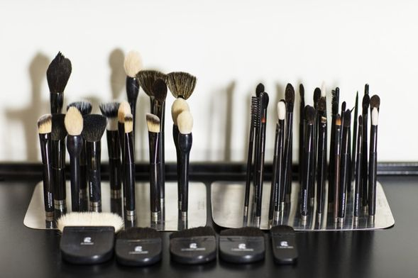 Rae's makeup brushes take pride of place in her office
