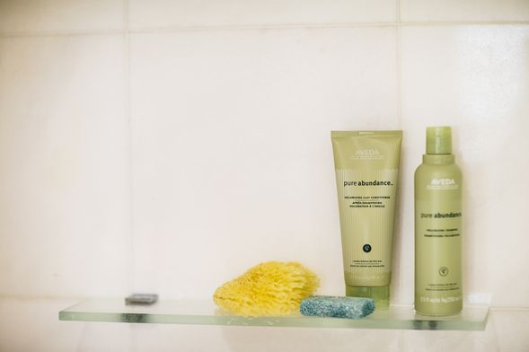 In her shower: Aveda Pure Abundance shampoo and conditioner