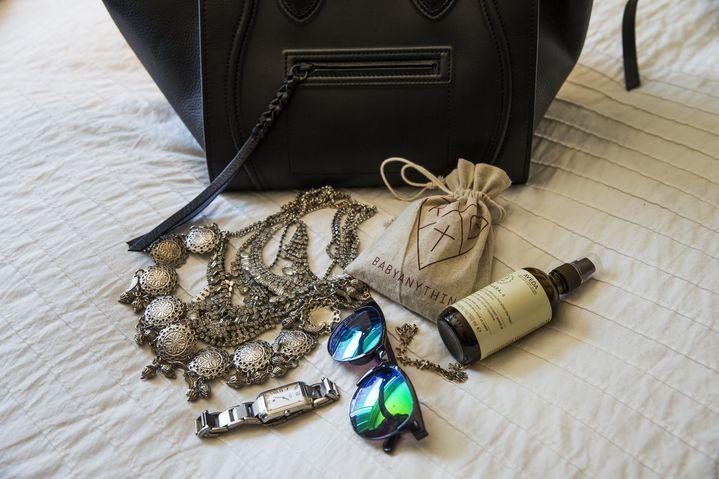 In Elle's handbag, jewellery, sunnies and Aveda Chakra Balancing Body Mist