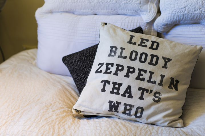 A witty cushion cover gives character to Elle's bedroom
