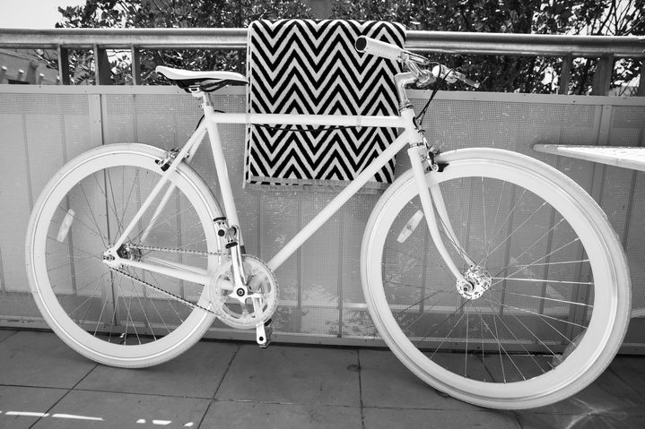 On Elle's balcony: a shiny white bicycle