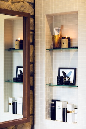 Chanel No 5, Narciso Rodriguez and Sodashi take pride of place in the bathroom.