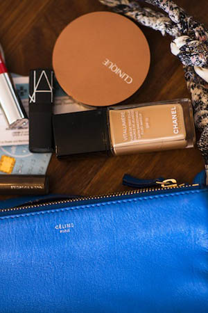 In Somer's Celine pouch: Clinique bronzer, Nars lipstick and Chanel Vitalumiere Foundation