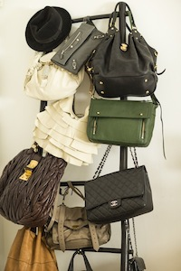 A portion of Kelly's extensive handbag collection