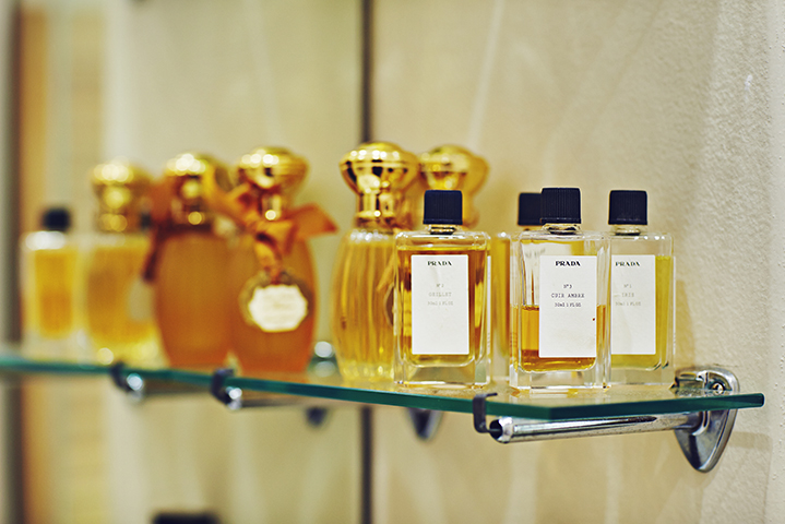 An assortment of Prada perfumes are displayed in the guest bathroom