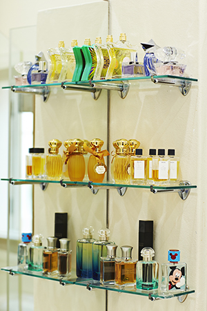 Shelves of Trimex fragrances in the guest bathroom.