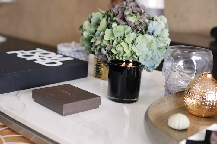 Coffee tables and candles by Koh living