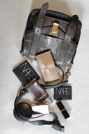 In Fil's Proenza Schouler mini PS1 bag: Charlotte Tilbury, NARS, Becca and M.A.C