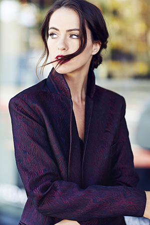 Sigourney wears  MAC Lip Liner in Garnet  and  MAC Lipstick in House Wine . Blazer by   Ellery  .