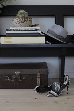 A Bec & Bridge Akubra hat, Celine shoes and trunk which belonged to her husbands grandmother decorate Bridget's home