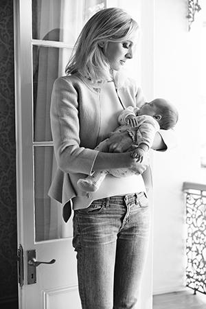 Nursing her baby, Charlotte