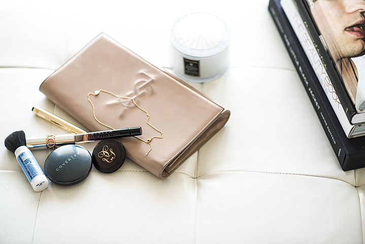 The most important necessity in her clutch: Cover FX cream foundation